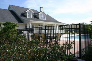Residential Fence in Kenner, Louisiana surrounding a swimming pool.