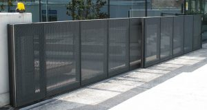 Secure fence and access gate located in Kenner for commercial and business property